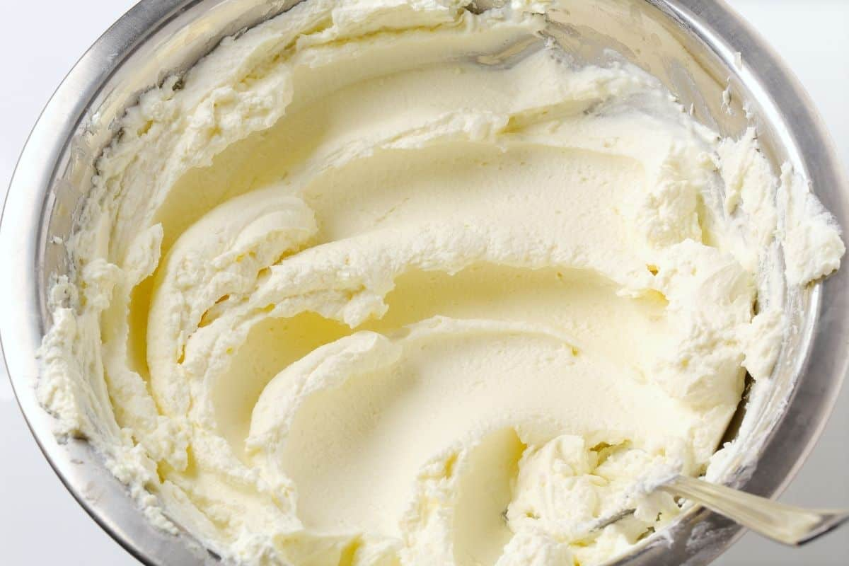 cream cheese that has been stirred in glass bowl